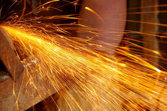 Flying sparks. From an angle grinder stock image