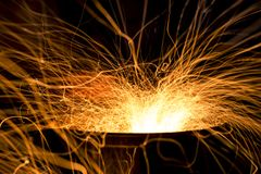 Flying sparks from a barbecue grill. Nice dynamic abstact image Royalty Free Stock Photography
