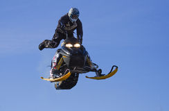 Flying sportsman on snowmobile Stock Photography