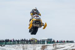 Flying sportsman on snowmobile Stock Image