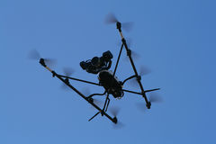 Flying Spy Surveillance camera copter Stock Image