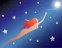Flying With a Star. Woman silhouette being carried by a star in the darkness of the universe Royalty Free Stock Image