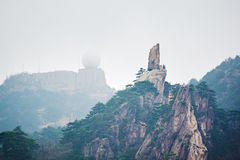 The flying stone and Guangmingding Royalty Free Stock Photography