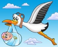 Flying stork with baby Royalty Free Stock Images