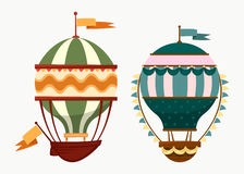 Flying striped air ballons with flags. Hot air flying balloons with ballast and flag banner. Old striped airship transport. Outdoor sport and adventure, holiday Stock Image