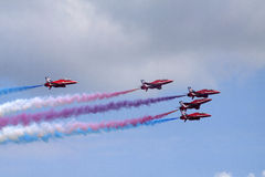 Flying stunt pilots in the air. Royalty Free Stock Image