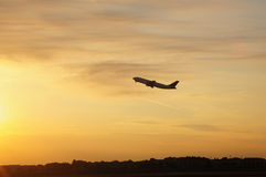 Flying into the sunse Royalty Free Stock Photo