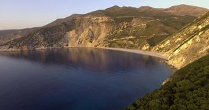 Flying on sunset above famous Myrtos beach in Kefalonia stock video footage