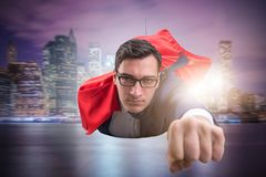 The flying super hero over the city royalty free stock photo