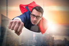 The flying super hero over the city stock photography