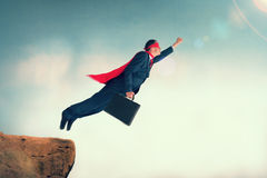 Flying superhero businessman Stock Image