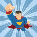 Flying Superhero with Red Cape and Fist Ready to Fight. Superhero flying in a blue costume with red cape vector illustration