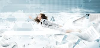 Flying superwoman. Young pretty businesswoman flying and screaming in megaphone Royalty Free Stock Photos