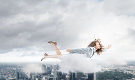 Flying superwoman Stock Image