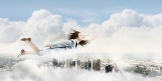 Flying superwoman Stock Photo