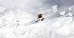 Flying superwoman Stock Photos