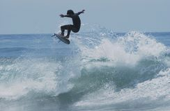 Flying Surfer. Surfer catapulting out of wave getting air Royalty Free Stock Photos