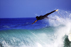 Flying surfer. Surfer diving over a wave, margate, South Africa Royalty Free Stock Photo