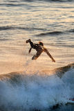 Flying Surfer. A silhouette of a surfer flying through the air Royalty Free Stock Photography
