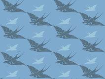 Swallows vector. Flying swallows seamless background - cute birds in shades of grey and blue Royalty Free Stock Image