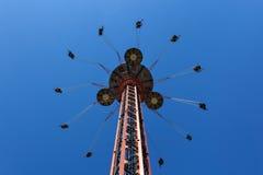 Flying swing carousel against blue sky Stock Photography