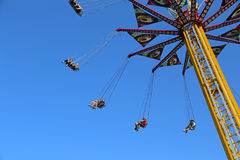 Flying swing carousel against blue sky Royalty Free Stock Photos