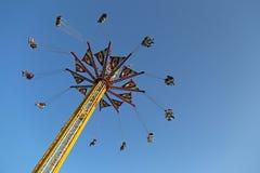 Flying swing carousel Stock Photos
