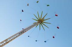 Flying swing carousel on fun fair stock image