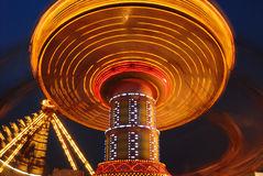 Flying swing at night Royalty Free Stock Images