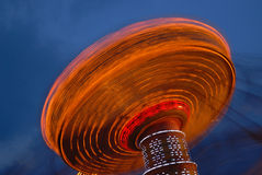 Flying swing at night. Motion blur Royalty Free Stock Photography