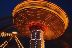 Flying swing at night. Motion blur Royalty Free Stock Photos