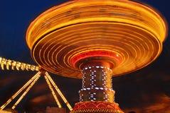 Flying swing at night. Motion blur Stock Image