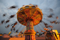 Flying swing at night. Rotating flying chairs  in chengdu happy valley,China Stock Photo