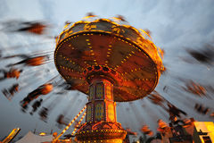 Flying swing at night. Rotating flying chairs  in chengdu happy valley,China Royalty Free Stock Photo