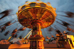 Flying swing at night. Rotating flying chairs in chengdu happy valley,China Stock Images