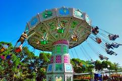 Flying swing at ocean park hong kong. Visitors riding the flying swing at ocean park, hong kong stock image