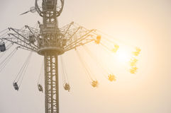 Flying swing in theme park royalty free stock photo