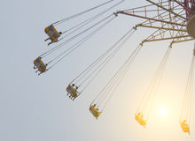 Flying swing in theme park stock images