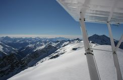 Flying in the Swiss Alps in Winter Stock Images