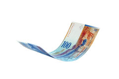 Flying Swiss Franc note, isolated Royalty Free Stock Images