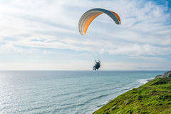 Flying tandem paragliders over the sea and near the mountains, beautiful landscape view Royalty Free Stock Photos