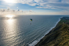 Flying tandem paragliders over the sea and near the mountains, beautiful landscape view Royalty Free Stock Photo