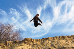 Flying teenager in sun light Royalty Free Stock Images