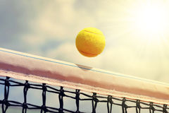 Flying tennis ball. Tennis ball flying over the net royalty free stock photos