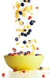 Flying to the bowl corn flakes with berries. Isolate on white Royalty Free Stock Photography
