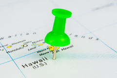 Flying to Hawaii. Draw-pin stick into real map, identification of final destination, Hawaii Royalty Free Stock Photos