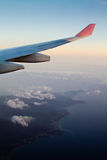 Flying to the mainland during Sun set. The airplane is flying pass the coast to the mainland during sunset Stock Photography