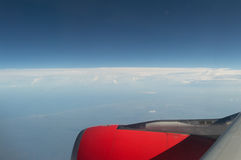 Flying to New Horizons – Above the Clouds View Stock Images