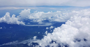 Flying in to Port Moresby Papua New Guinea. Looking down at the sea and land Stock Image