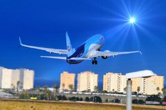 Flying to the sun - Passenger Holiday charter Flight Plane Stock Photo